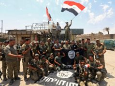 Flag waving Iraqi soldiers celebrated impending victory in Mosul