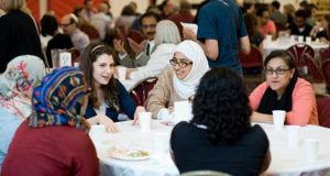 Moroccan Americans socializing at the Maghreb Association of North America in Chicago, IL.