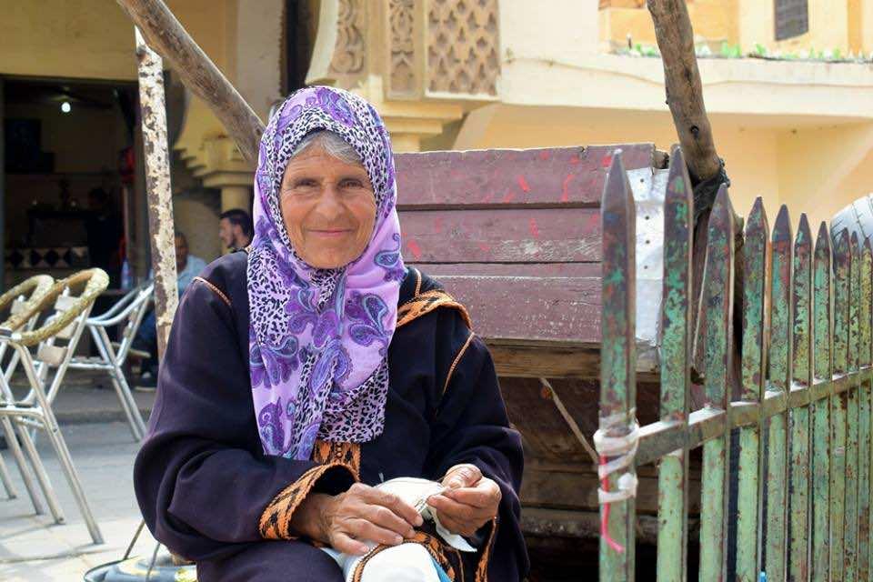 A sewing grandmother. Photo by ieva kambarovaite