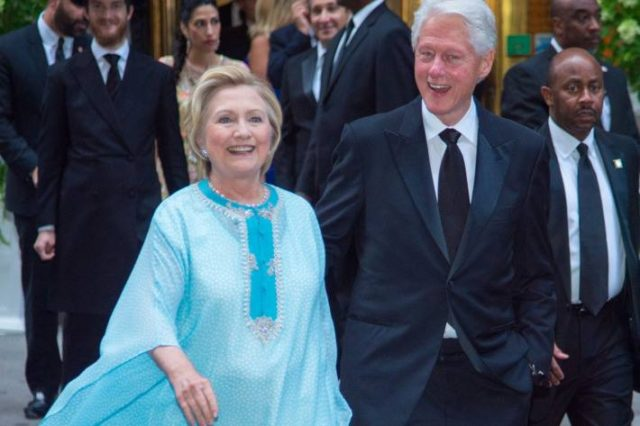 Hillary Clinton Swaps Signature Pantsuit Look for Flowy Caftan