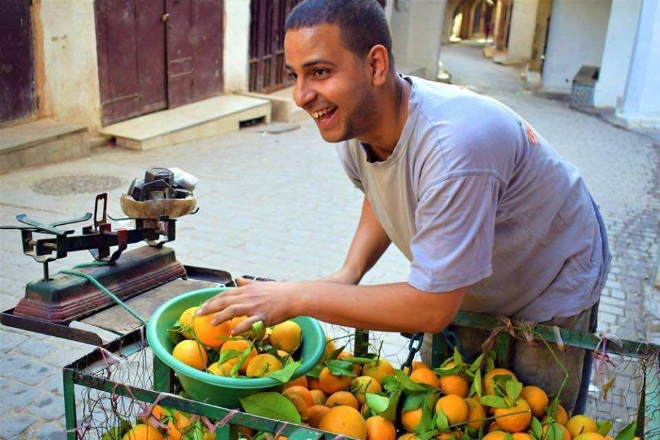 Orange seller. Photo by ieva kambarovaite