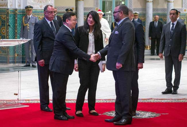 King Mohammed VI of Morocco greets Wang Chuanfu, the founder of BYD auto