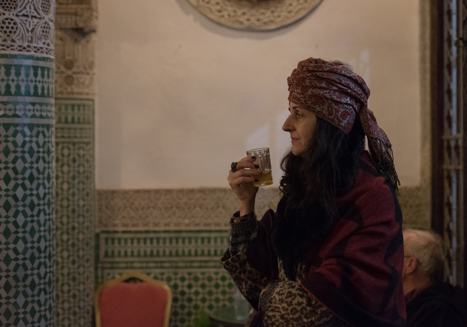 Swiss photographer and Fes Gathering panelist Eva Maria Ocherbauer listens as organizers introduce the night's artists Thursday at ALIF Riad in the Fez Medina.
