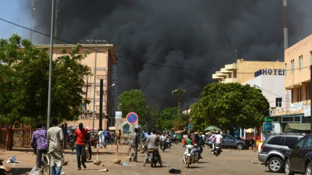 Ahmed Ouoba/AFP/Getty Images Black smoke billows above downtown Ouagadougou this morning