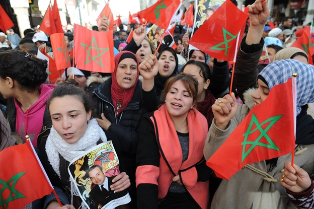 Moroccans waiving national flag