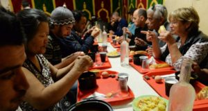 """People eat at the breaking of fasting of the second day of Ramadan, in the premises of the Seeds of Solidarity (""""Graine de Solidarite"""") association, on June 29, 2014, in Bordeaux. Founded in 1986, Seeds of Solidarity gives away free meals all year in the streets of Bordeaux, and serves up to 300 meals every night during ramadan, to homeless and deprived people, regardless if they are muslim or not. AFP PHOTO / MEHDI FEDOUACH (Photo credit should read"""