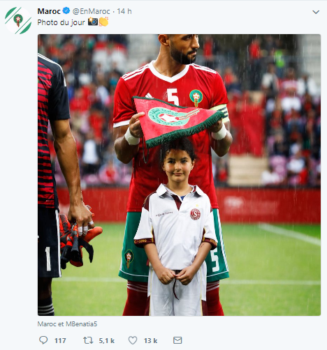 A Picture of Mehdi Benatia Sheltering a Child from Rain Goes Viral