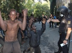 Migrants Violently Jump Fence into Spanish Enclave
