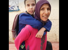 Photo of Mom Carrying Special Needs Son to School Inspires Moroccans