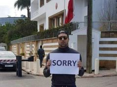 "Photo of Moroccan Man in front of Denmark Embassy holding ""SORRY"" Banner"