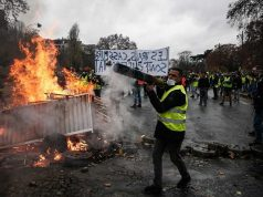 Paris Police Fire First Tear Gas Amid Escalating Protests against 'Arrogant Macron'