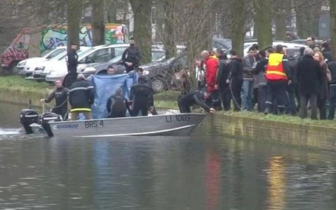 Police recovering the body from the canal