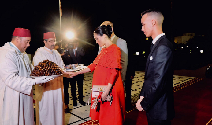 Pregnant Duchess Meghan Markle Wears Red Dress to Honor Morocco