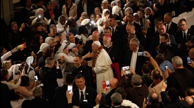 Christians happy to welcome Pope Francis in Rabat's Cathedral. Photo Credit: Sebastian Bouknight/ Morocco World News
