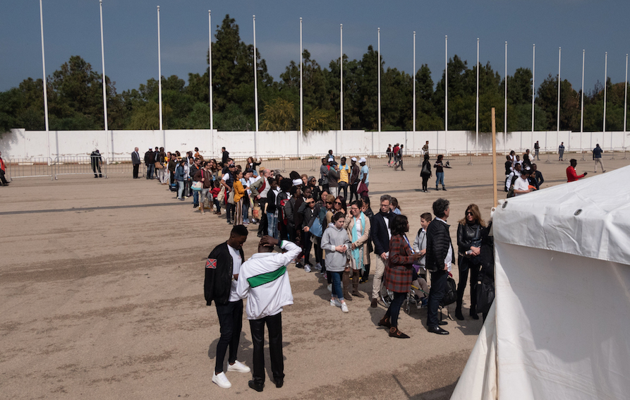 Hundreds of people filed through security lines to attend Pope Francis' Sunday afternoon mass at the Prince Moulay Abdellah Sports Complex during the last day of his visit. Photo by Stephen Higgins/Morocco World News.