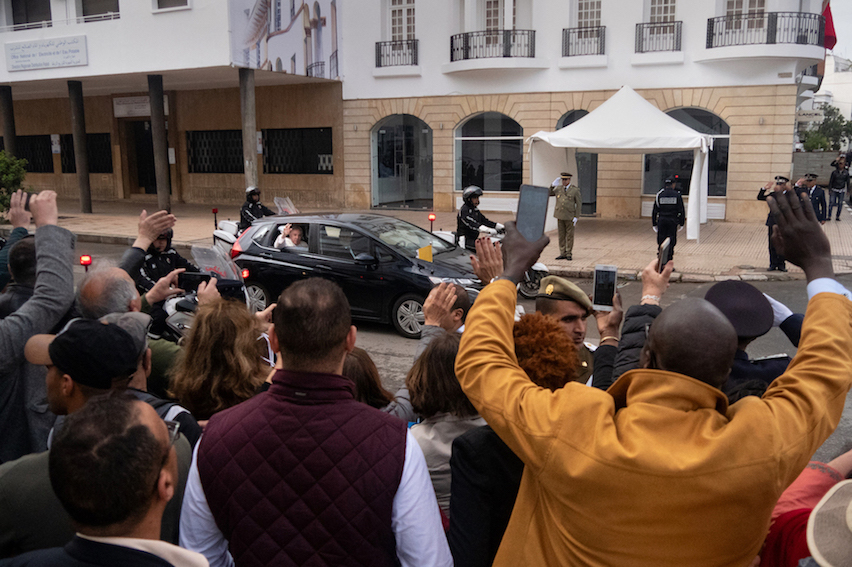 Supporters wave at Pope Francis as he drives to St. Peter's Cathedral in Rabat to a give speech during the second day of his visit to Morocco. Photo by Stephen Higgins/Morocco World News.