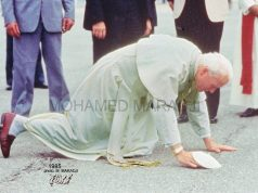 Pope John Paul kneeling to kiss Moroccan soil. August, 1985.