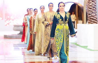 caftans in a show in Abu Dhabi