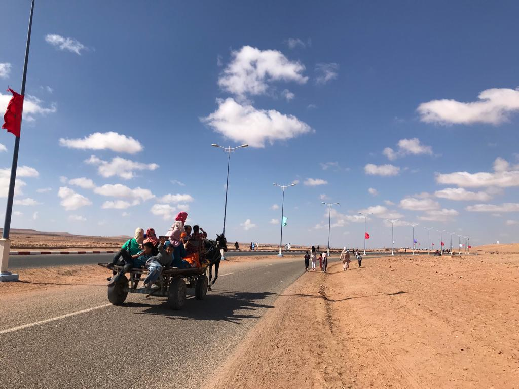 People make their way to the Tan-Tan moussem grounds, a couple of kilometers outside town.