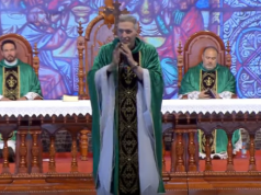 Video: Woman in Brazil Violently Pushes Priest Off Stage
