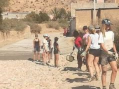 Moroccan media shared videos and photos of a group of young Belgian volunteers from Bouworde building a road in the remote village of Adar. The initiative earned praise for the girls from people across Morocco. However, the girls' attire, short shorts, also attracted strong criticism.