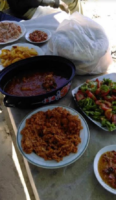 Eid al adha food served at a refugee camp