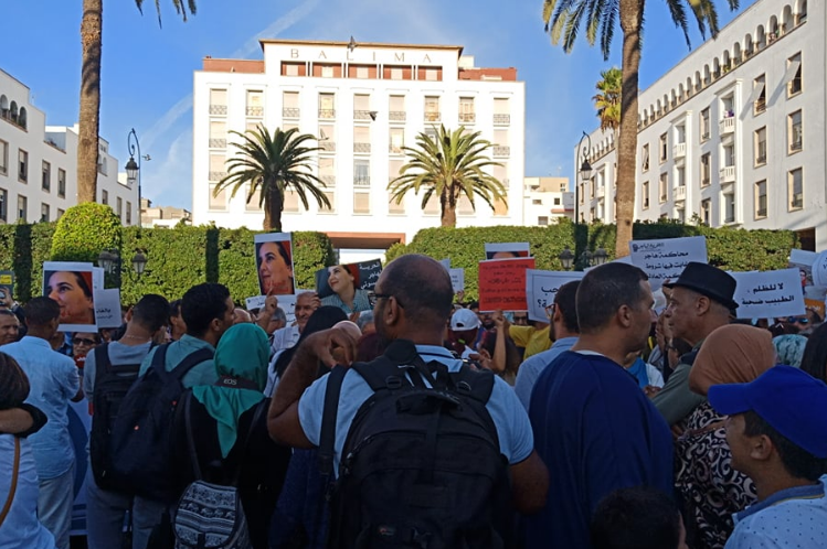Protesters holding banners to show support with Hajar Raissouni. Photo Credit: Morocco World News