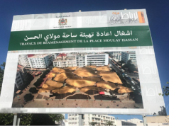 construction sign for a project which would cover the plaza with an immense roof
