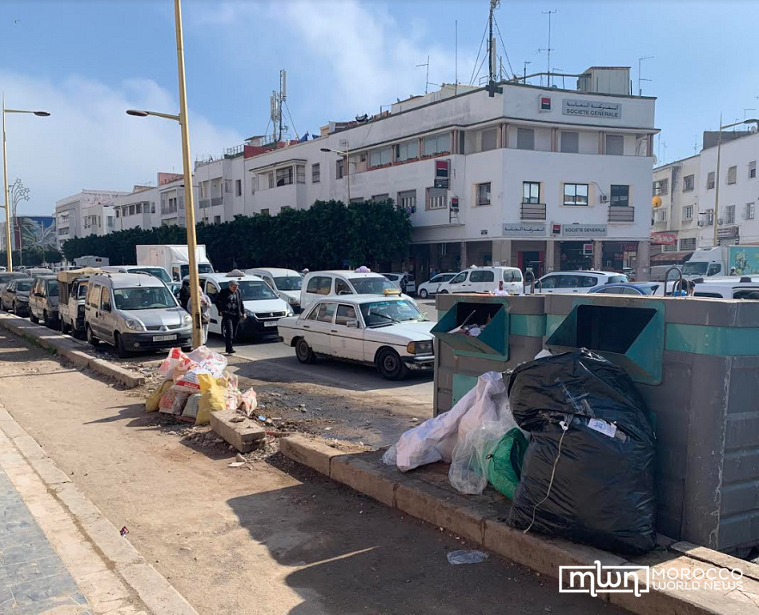 Large, overfilled dumpsters infrequently placed in neighborhoods, Hassan district (3)