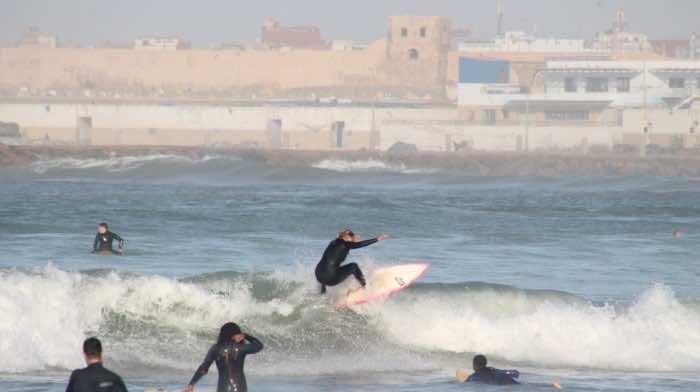 Surfers enjoy the water at Rabat beach