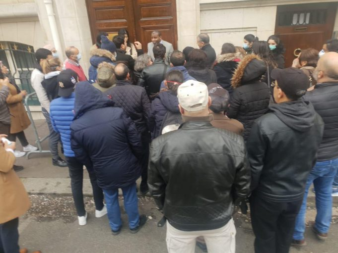 Moroccan tourists stranded in France talking to member of the Moroccan embassy in Paris