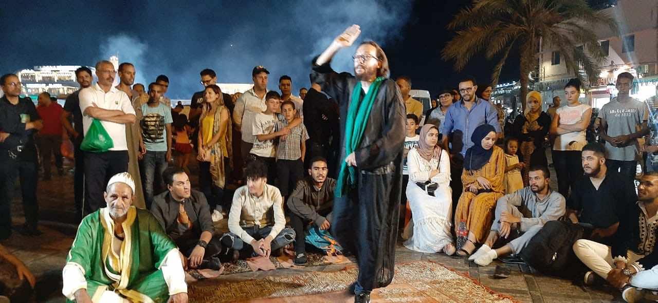 Photo of award-winning storyteller, Brahim Dalwali performing at a storytelling festival