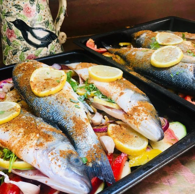 Cooking Moroccan roasted sea bass with peppers