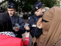 Mandated Face Masks Revive Debate Over France's Burqa Ban