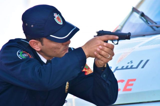 Police Inspector Uses Weapon Against State of Emergency Violators