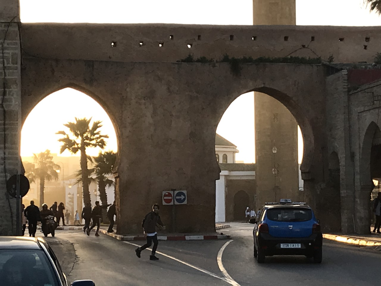 Sunlight filters through one of the main gates in the Medina of Rabat, as children play and locals mingle. Photo taken on Monday, Feb. 24, 2020 in Rabat, Morocco.