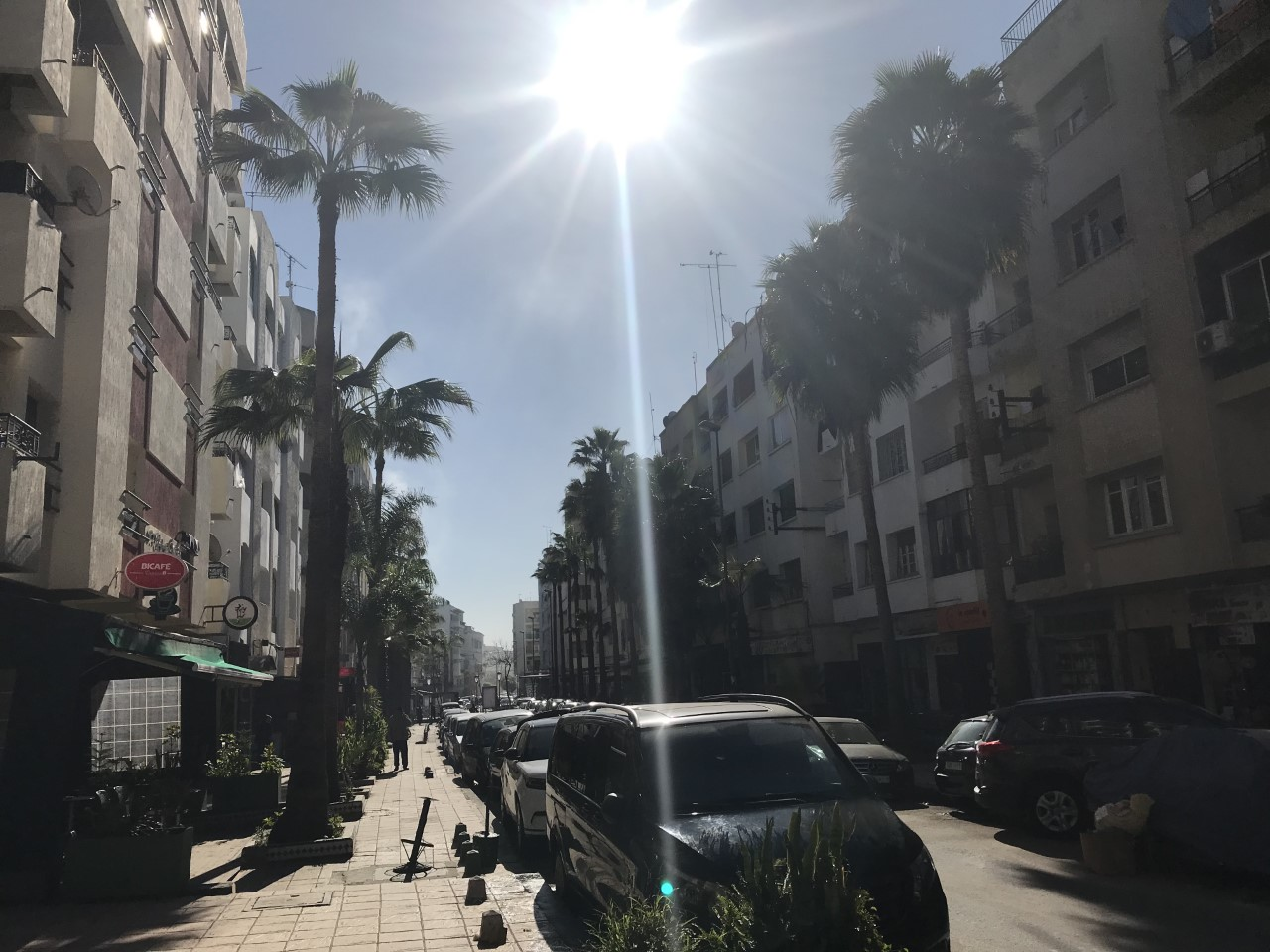 The sun illuminates a busy street in central Rabat