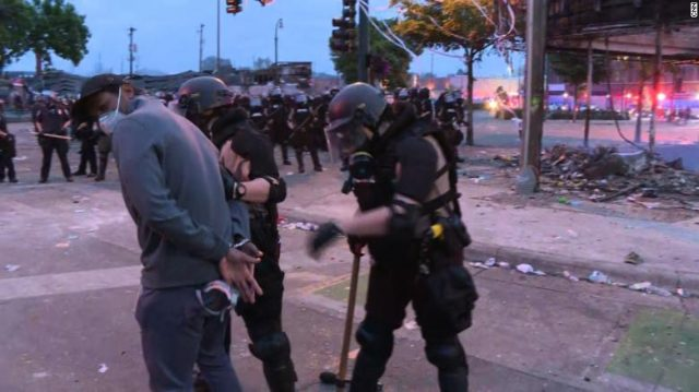 US Questions Racial Biases as Police Arrest Reporters on Live TV